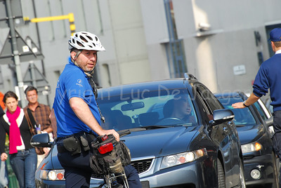 """A police officer of the local police of the city of Ghent (Gent), Belgium, member of the bike team, commonly called """"de draken"""" (the dragons)."""