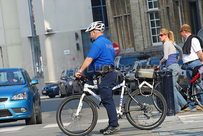 """A police officer of the local police of the city of Ghent (Gent), Belgium, member of the bike team, commonly called """"de draken"""" (the dragons). He rides a Cannondale bike."""