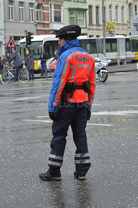 A bicycle cop of the local police of Ghent (Gent), Belgium, standing in the rain.