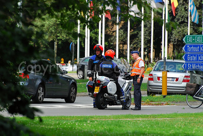 Police officers of the local police of Bruges (Brugge), Belgium on their motorcycle.