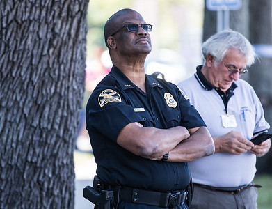 St Petersburg Police Chief, Anthony Holloway watches as the first section of the wall is put into place.