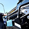 Lowell Police Capt. James Hodghon, looks over the new ATV type police vehicle, that will be used to access areas that a larger vehicle can't go. SUN/David H. Brow