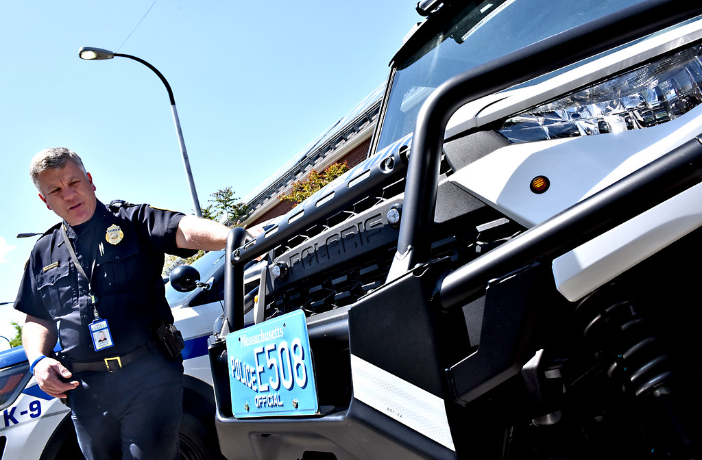 . Lowell Police Capt. James Hodghon, looks over the new ATV type police vehicle, that will be used to access areas that a larger vehicle can\'t go. SUN/David H. Brow