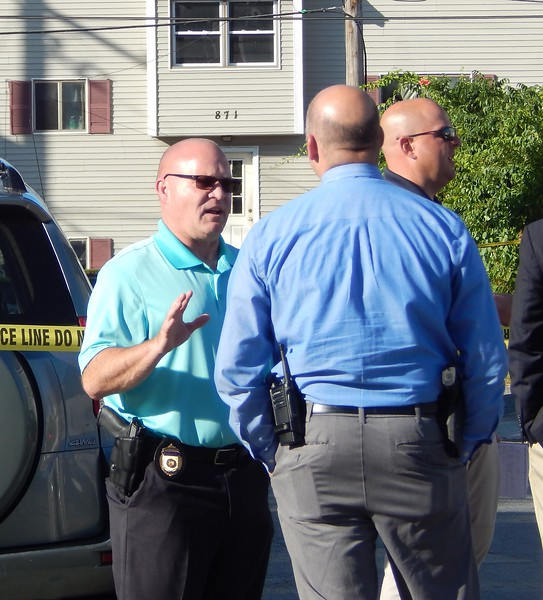 Lowell police gathered at the scene of a death on Queen Street in the city's Highlands neighborhood on Monday. AARON CURTIS/LOWELL SUN