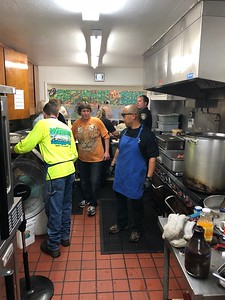 Members of Eureka Police Department's CSET team were at St. Vincent de Paul's dining facility on Thursday afternoon serving up a barbecue meal. (Eureka Police Department -- Contributed)