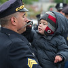 Sgt Chris Garcia's son is more ineterested in his father's sunglasses than proceedings at the Police Memorial Service and Park rededication. SENTINEL & ENTERPRISE / Jim Marabello