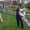 Fitchburg Officer Stacey Cronin takes her nephew for a spin after the Fitchburg Police Memorial Services and rededication of Police Memorial Park. SENTINEL & ENTERPRISE / JIm Marabello