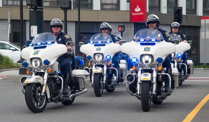 The Fitchburg Police Motorcycle Unit leads the procession down Main St to the Police Memorial in Depot Square. SENTINEL & ENTERPRISE / Jim Marabello