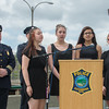 Amanda Porter, Hannah Farineau, Kennedy Jackson and Sydney Arnold sing God Bless AMerica during the Police Memorial Services and rededication of Police Memorial Park. SENTINEL & ENTERPRISE / JIm Marabello