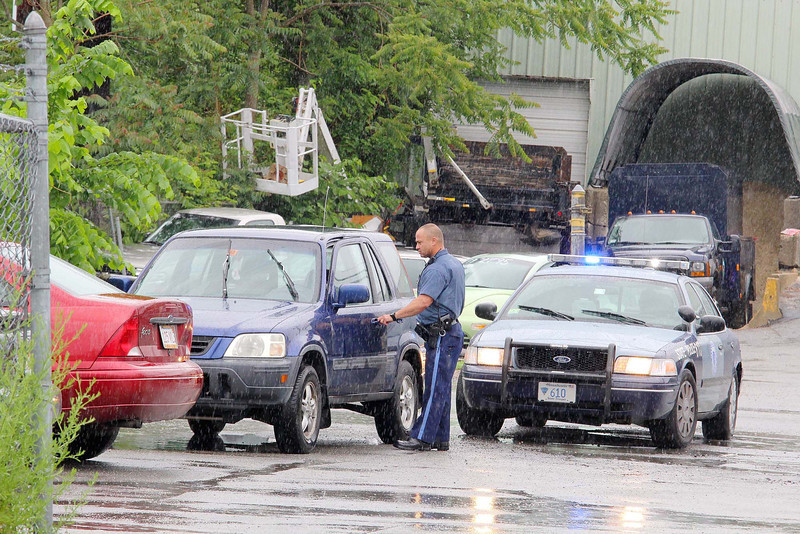 A State Trooper arrested three people during a traffic stop in the parking lot of the Sentinel & Enterprise on Friday afternoon. SENTINEL & ENTERPRISE/JOHN LOVE
