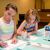 Lenaia Nolasco, 8, and Rachel Decoste, 8, make thank you cards for members of the Fitchburg Police Department at  Elm Street Community Church on Wednesday afternoon. SENTINEL & ENTERPRISE / Ashley Green