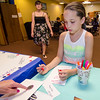 Lenaia Nolasco, 8, makes a thank you card for members of the Fitchburg Police Department at  Elm Street Community Church on Wednesday afternoon. SENTINEL & ENTERPRISE / Ashley Green
