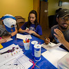 Jonathan Poole, Caitie Mayo and AJ Williams make thank you cards for members of the Fitchburg Police Department at  Elm Street Community Church on Wednesday afternoon. SENTINEL & ENTERPRISE / Ashley Green