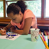 Anmerai Nolasco, 12, makes a thank you card for members of the Fitchburg Police Department at  Elm Street Community Church on Wednesday afternoon. SENTINEL & ENTERPRISE / Ashley Green