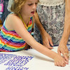 Rachel Decoste, 8, makes a thank you card for members of the Fitchburg Police Department at  Elm Street Community Church on Wednesday afternoon. SENTINEL & ENTERPRISE / Ashley Green