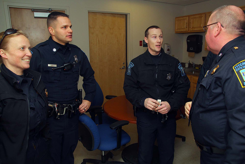 Fitchburg State University Police Chief Jim Hamel chats with Sgt Sarah Camelo, Patrolman Derrick Camelo and Patrolman Eric Schmitt on Monday Hamels last day on the job. They where wishing him good luck. SENTNEL & ENTERPRISE/JOHN LOVE