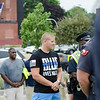 Officer Timothy Friend, wearing a 'blue lives matter' T-shirt, joins members of the Fitchburg Police Department to honor the fallen Dallas police officers involved in a shooting on Thursday evening. SENTINEL & ENTERPRISE / Ashley Green