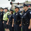 Members of the Fitchburg Police Department gathered at the police memorial at noon on Friday to honor the fallen Dallas police officers involved in a shooting on Thursday evening. SENTINEL & ENTERPRISE / Ashley Green