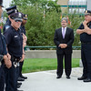 Mayor Stephen DiNatale, along with Chirf Ernie Martineau, joins members of the Fitchburg Police Department to honor the fallen Dallas police officers involved in a shooting on Thursday evening. SENTINEL & ENTERPRISE / Ashley Green