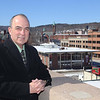 Fitchburg Police Chief Robert DeMoura looks over the city from the parking garage on Boulder Drive on Friday afternoon.  SENTINEL & ENTERPRISE/JOHN LOVE