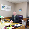 Fitchburg Police Chief Robert DeMoura at his desk in his office at the station. SENTINEL & ENTERPRISE/JOHN LOVE