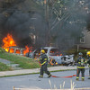 Gardner Firefighters prepare to attack 2 cars on fire in the driveway of 99 Graham St.   SENTINEL&ENTERPRISE/ Jim Marabello