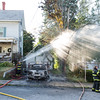 Gardner Firefighters mop up and overhaul 2 cars on fire in the driveway of 99 Graham St.  SENTINEL&ENTERPRISE/ Jim Marabello