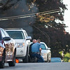Gardner police officers and a State Trooper take cover with weapons drawn as 2 cars burn in the driveway at 99 Graham St. SENTINEL& ENTERPRISE/ Jim Marabello
