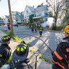 Firefighters from Westminster stand by as Gardner Firefighters mop up and overhaul 2 cars on fire in the driveway of 99 Graham St.  SENTINEL&ENTERPRISE/ Jim Marabello