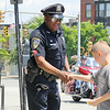 Leominmster Police Officer Randy Thomas has a new walking beat downtown. This will give him time to stop and chat with anyone downtown like Blake Gaudet, 8, who came down town with his mom. SENTINEL & ENTERPRISE/JOHN LOVE
