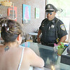 Leominmster Police Officer Randy Thomas has a new walking beat downtown. He will be stopping into business's in the downtown and talking to them check in ad make sure they have no problems. He stopped into Sweet Creation's by Gloria to talk to the owner Gloria Castano on Wednesday afternoon. SENTINEL & ENTERPRISE/JOHN LOVE
