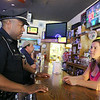 Leominmster Police Officer Randy Thomas has a new walking beat downtown. He will be stopping into business's in the downtown and talking to them check in ad make sure they have no problems. He stopped into Christopher's Pub and chatted with Manager/Bartender Meagan Broderick on Wednesday afternoon. SENTINEL & ENTERPRISE/JOHN LOVE