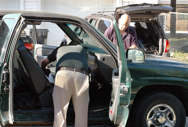 Police investigators go through the vehicle of Jim Kenneth Bailey who reportedly shot several police officers then killed himself during a shootout Thursday night in Pendleton.