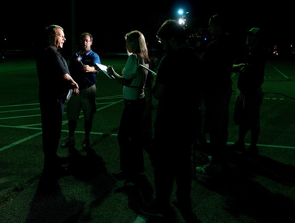 Madison County Emergency Management and Homeland Security Public Information Officer Todd Harmeson gives a press briefing in the Pendleton Heights parking lot early Friday morning.