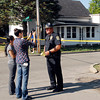 Pendleton Police Chief Marc Farrer is interviewed by the media at the shooting site on Water Street in Pendleton.