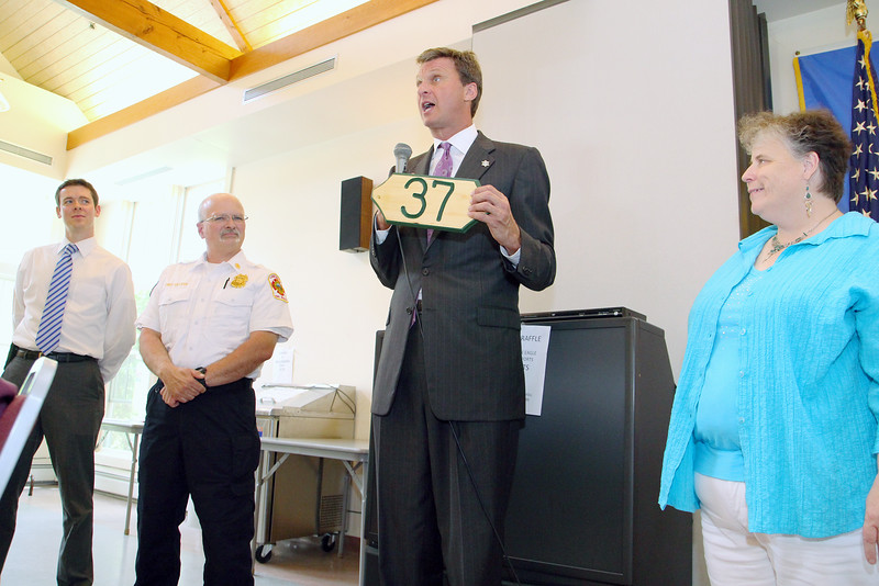 The Worcester County Sheriff's Office, the Lunenburg Fire Department and the Council on Aging have teamed up to help put numbers on seniors houses that may not have them. Sheriff Lewis G. Evangelidis, holding house number, talks about the program at the Lunenburg Senior Center on Thursday afternoon surrounded by Shawn McKenna, far left, the community outreach coordinator for the sheriff's office, Lunenburg Fire Chief Patrick Sullivan and Lunenburg Council on Aging Director Doreen Noble. SENTINEL & ENTERPRISE/JOHN LOVE