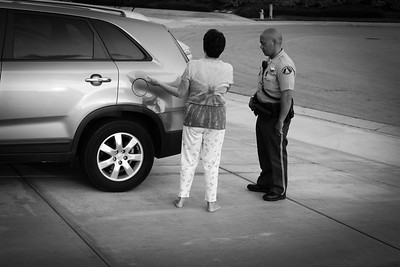 A Temecula homeowner speaks with a deputy  regarding suspicious persons in her neighborhood.