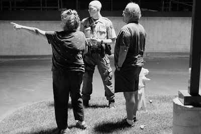 A deputy speaks with two residents of a apartment complex who called in a noise disturbance from the adjacent building.