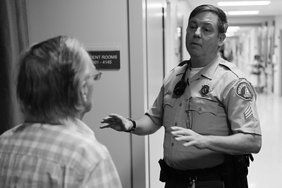 A sergeant speaks with the father of a patient at the Temecula Valley Hospital.