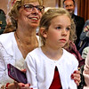 Listening to speakers at the annual Polish Flag Raising is Paula Olenick with her grandaughter, Julie Olenick,5, on her lap. The ceremony was moved inside Lowell City Hall because of the rain. SUN/David H. Brow