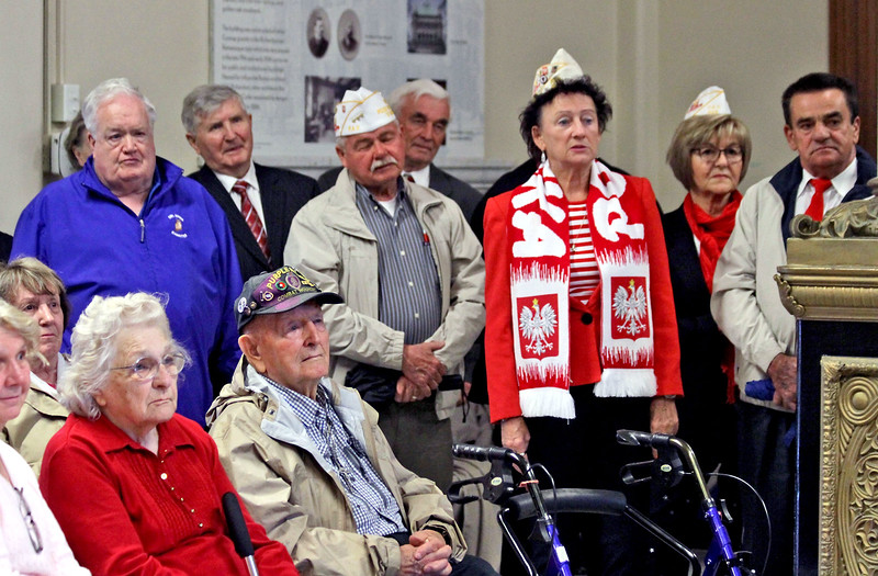 Attendees at the annual Polish Flag Raising moved inside Lowell City Hall because of rain. SUN/David H. Brow