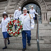 Diane and Wayne Parker carry the wreath together outside of City Hall while Thomas Stupakewicz and Paula Olenick Stupakewicz follow behind to raise the Polish Flag. SUN/Caley McGuane