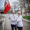 Thomas Stupakewicz and Paula Olenick Stupakewicz help raise the Polish Flag together outside of City Hall in Lowell. SUN/Caley McGuane