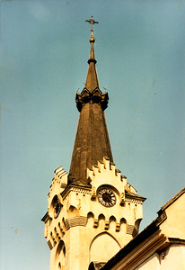 DEBICA - A close view of the belltower and clock of the Catholic Church.
