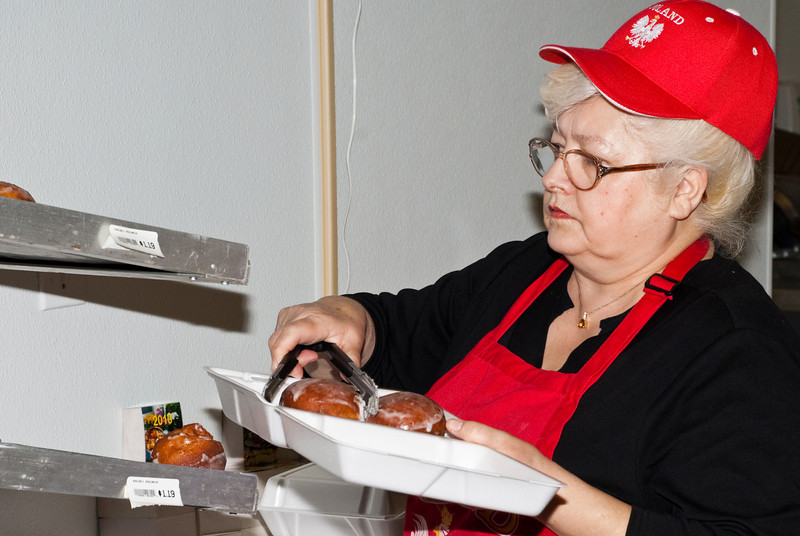 Alicza loading up a box of pączki for a customer at the Polish Store