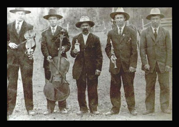 From left to right; Lige Buckner  , Stash Skoba  , Joseph Frank Maduzia Sr.  , Joseph Frank Maduzia Jr.  , Pete Maduzia  New Waverly - 1915  Photo courtesy of Johnny Maduzia