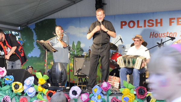 Our Lady of Czestochowa pastor Father Leszek took to the stage and sang a Polish song while the Brian Marshall and the Tex-slavic Playboy band played.  4th Annual Polish Festival Houston, Texas May 1, 2010