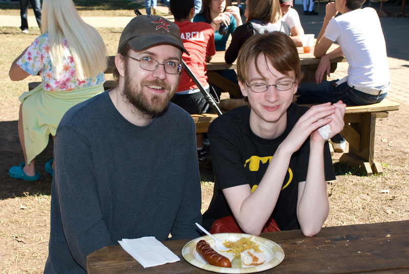 Young Couple Sharing A Plate Of Kielbasa
