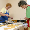 Members of the Polish Cultural Committee along with volunteers were cooking up some rosettes on Wednesday to have at the Lowell Folk Festival.  Rosettes are a form of Polish fried dough known as Chrusts. Cooking up some rosettes is Elizabeth Tsioulis and Florence Desmarais, on right, on Wednesday at the Polish National Home on Coburn Street in Lowell. SUN/JOHN LOVE