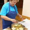 Members of the Polish Cultural Committee along with volunteers were cooking up some rosettes on Wednesday to have at the Lowell Folk Festival.  Rosettes are a form of Polish fried dough known as Chrusts. Cooking up some rosettes is Joan Davis on Wednesday at the Polish National Home on Coburn Street in Lowell. SUN/JOHN LOVE
